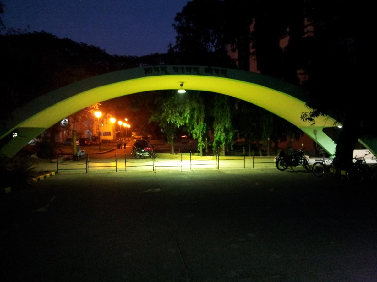 """Iconic arch with """"Knowledge is Supreme"""" (Gyanam Paramam Dyeyam)"""